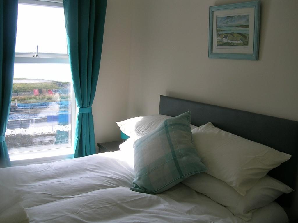 Port-na-glas Visit Portrush Northern Ireland Bedroom with view over the train station to the harbour and donegal