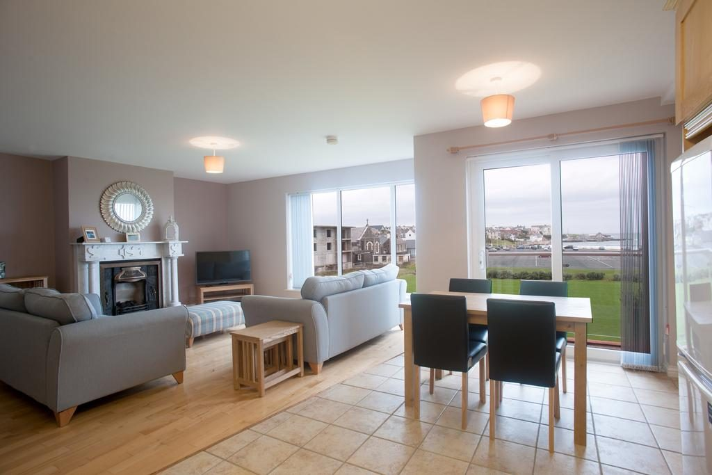 Portrush Seaview Apartments living room with dining area