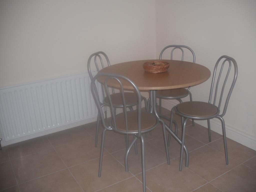The Blue House Apartments dining table
