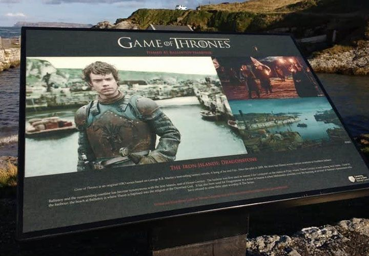 The Film location board for game of thrones at ballintoy harbour
