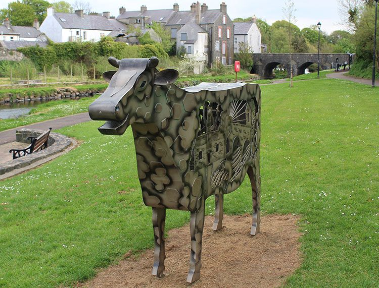 The smiling cow is a art project completed with the help of local students and catalonian students. it sits next to the river bush