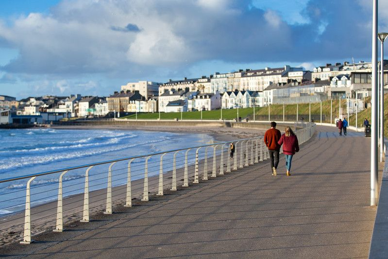 West-Strand-Portrush-couple walkng along the coastal path