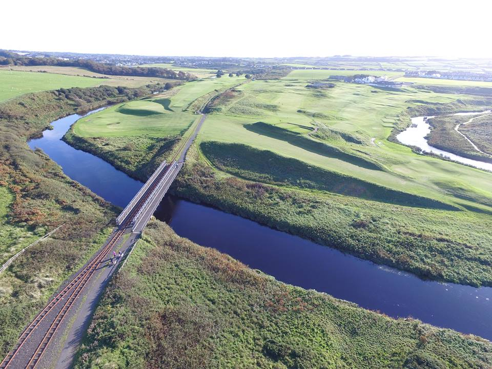 Bushfoot-Golf-Course-from-the-air-looking-back-over-the-course-towards-the-clubhouse-compressor